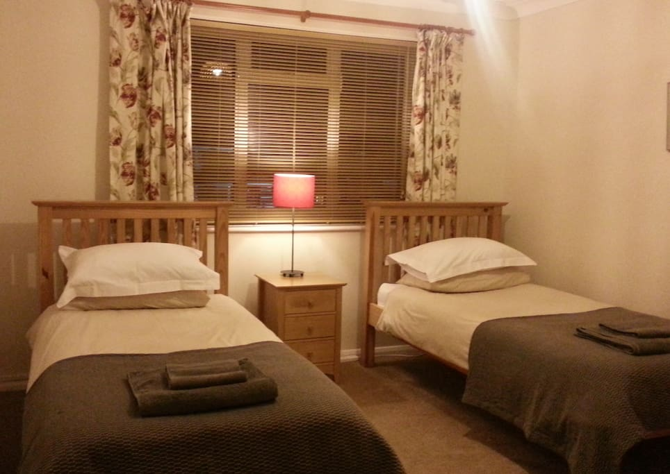 Twin room containing two single beds.