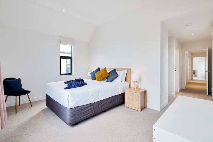 The main bedroom is really a hotel suite with a  large walk-in wardrobe and a full ensuite bathroom. This suite takes over the front of the house. You can hang anything precious in the walk-in wardrobe, and you don't have to share a bathroom.