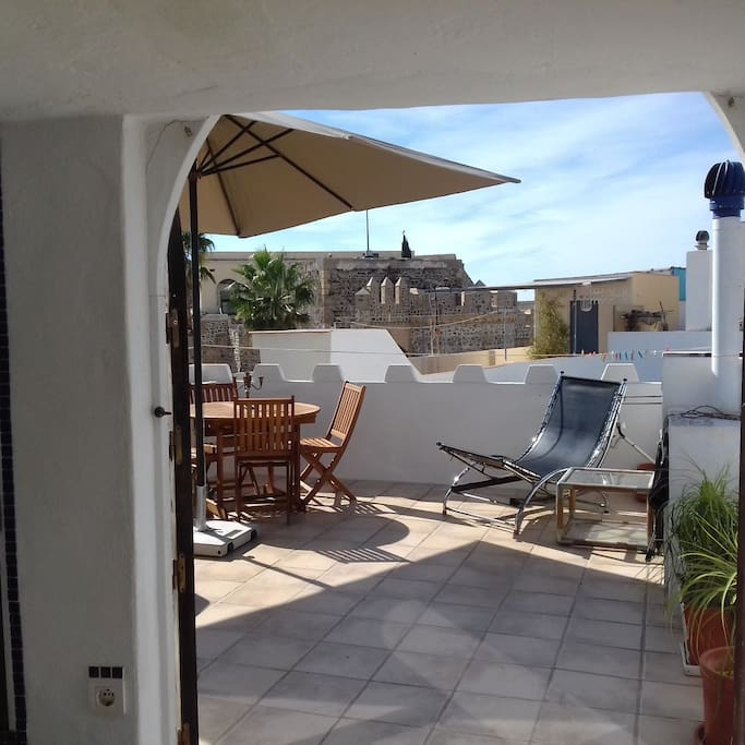View from the sun room out onto the terrace. Enjoy a barbeque and a drink whilst taking in the view of the castle.