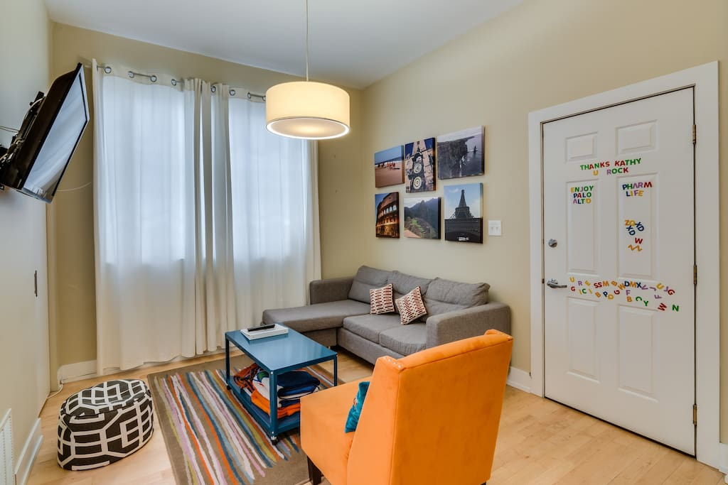 You enter my condo into my bright and cheerful living room - there is a new couch that pulls out into a full size bed!