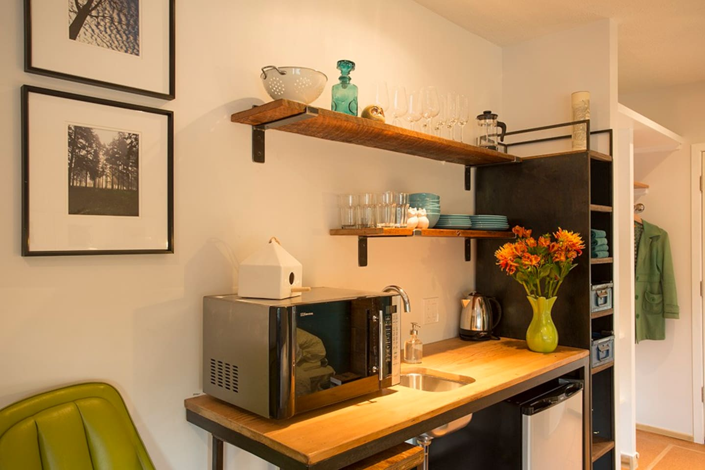Beautiful custom steel kitchen, made by local artists. Reclaimed wood countertop & shelves.