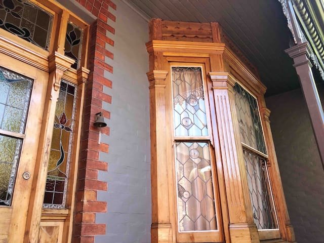 The front door and bedroom window. Styled with the grand features of a 1910 city home.