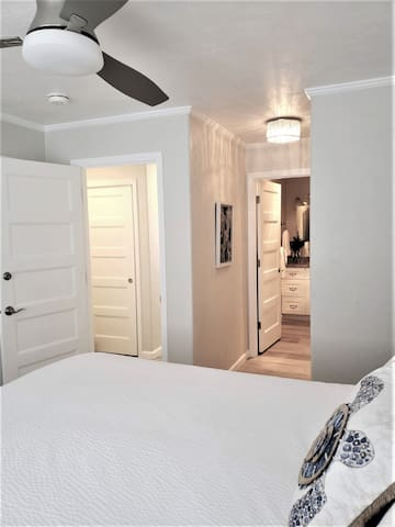 Luxurious King Bed with en-suite bath and a cooling ceiling fan for warm summer nights.