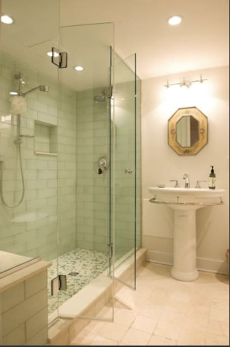 Gorgeous new Italian tile and glass guest bathroom (not shared). Two shower heads, shower bench, heated stone tile floor.
