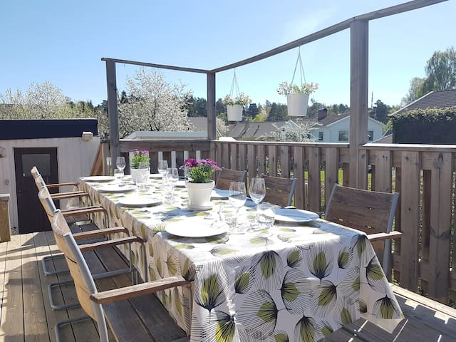 Sunny terrace with table that can fit 10 people
