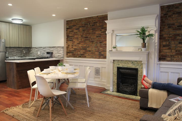 A welcoming sofa, dinner table and kitchen in the reception.