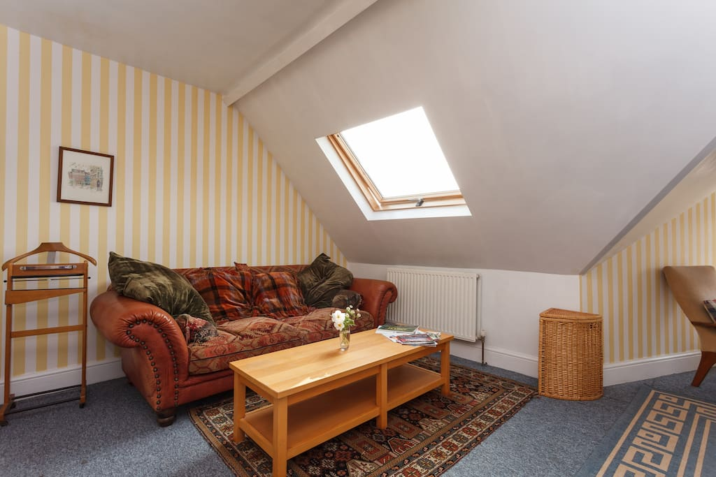 A cosy spot to relax, the big bright Velux window has a blackout blind, so you can sleep well. The room faces South and that window catches the early morning sun.