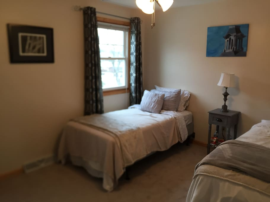 The guest room looks out onto the front garden and avenue. It has two twin beds, a minibar, TV, and a walk in closet available for guests.