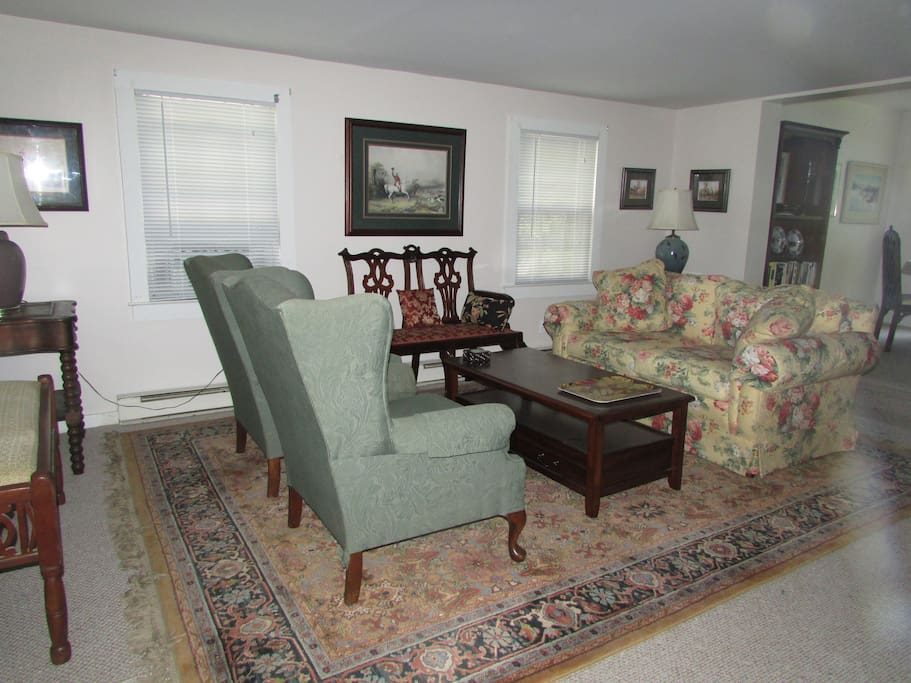 Living Room  seating four comfortably or six with the antique love seat.