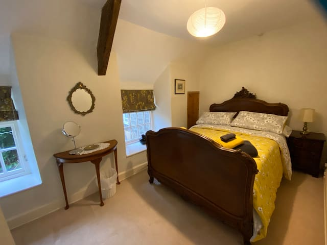 A gorgeous antique French bed is a lovely feature in the smaller bedroom.