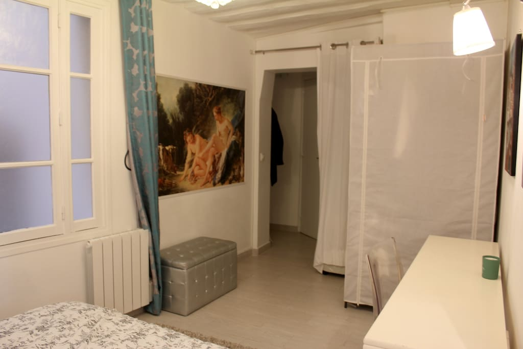 Room and view of hallway entrance.
