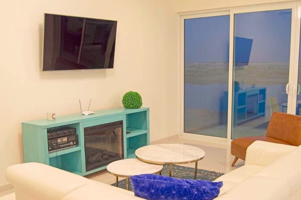 Get cozy in the electric chimney while enjoying music or watching HD TV plus a unique window view.
