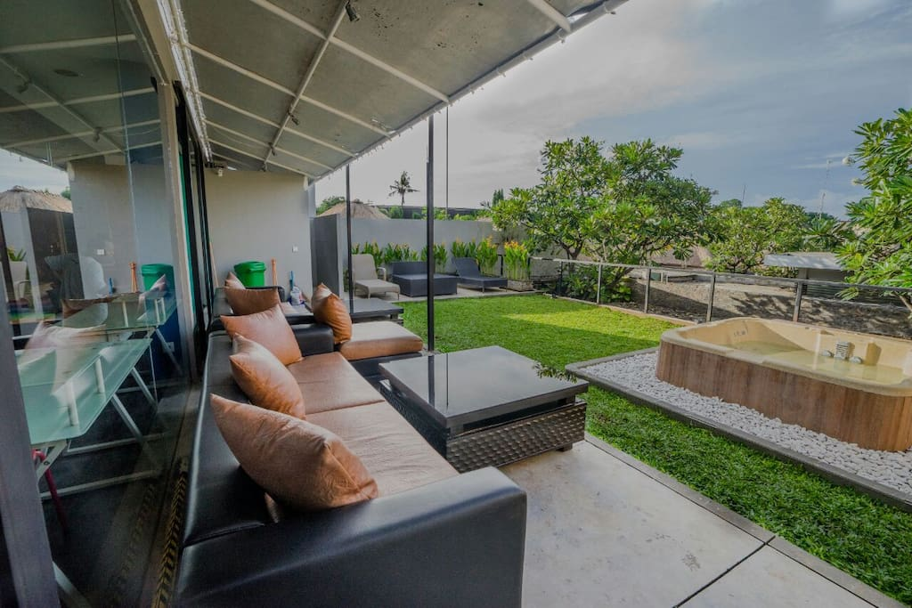 Enough room to enjoy lounging on the grass or a comfy sofa, taking a dip in the refreshing hot tub, or relaxing in a lounge chair!