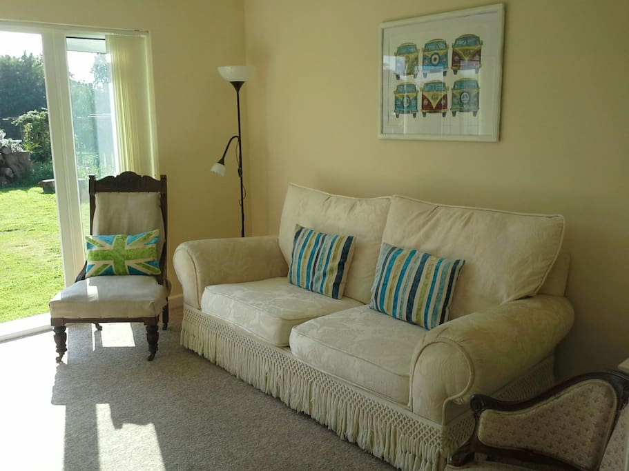 Well lit, spacious living room with double doors to the garden and freeview TV