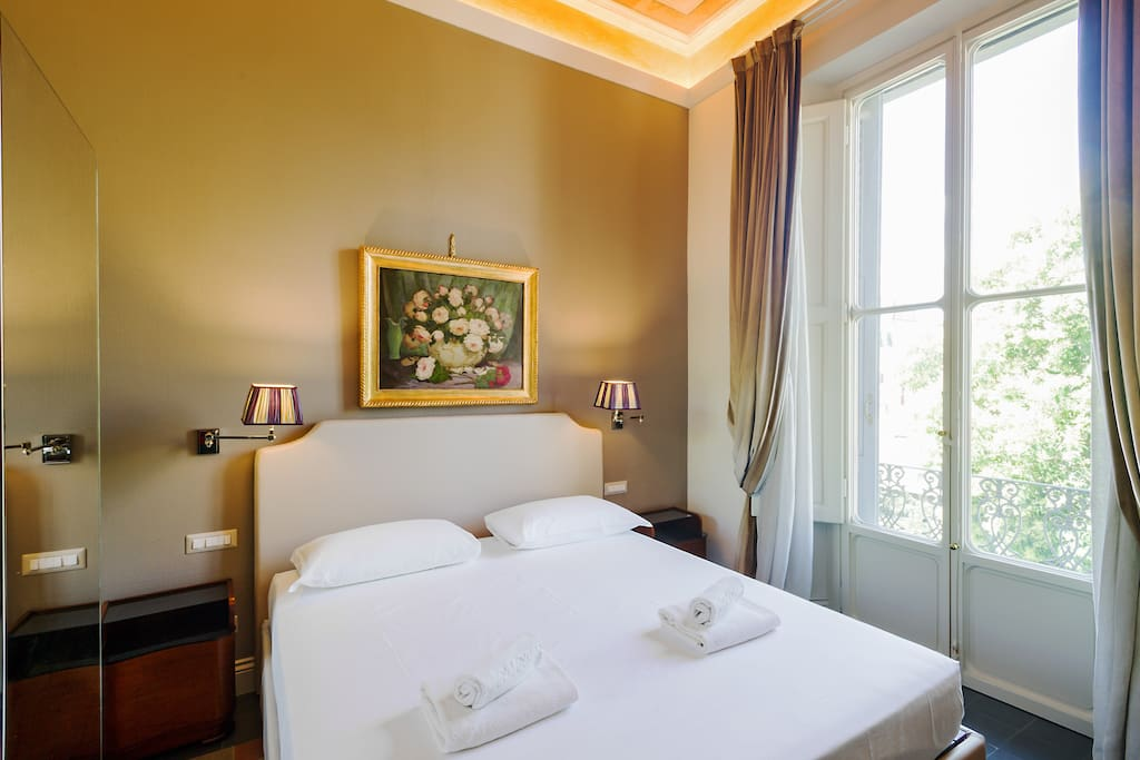 The Bedroom - The comfortable double bed with soft bed-linen and towels with private Terrace