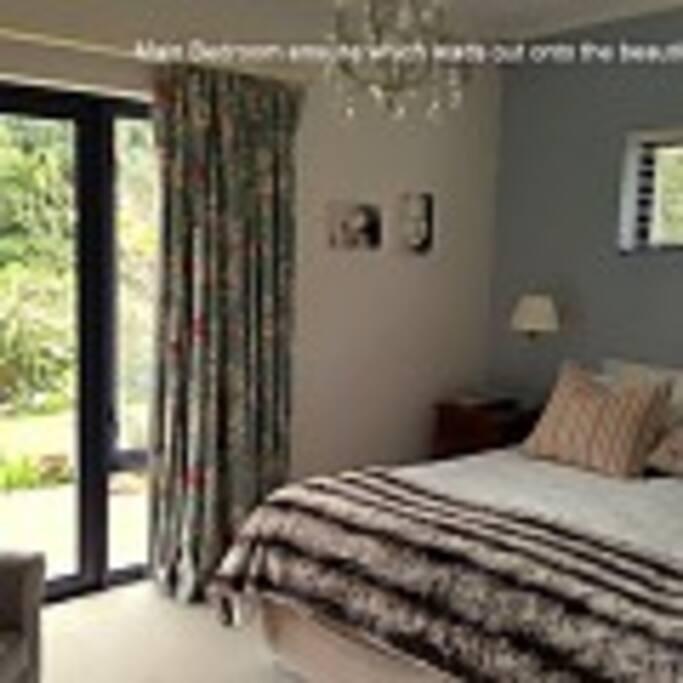 Main bedroom, king bed, doors opening out to garden