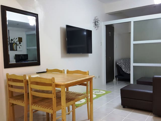 unit is  fully furnished. With aircon and kitchen appliances  (refrigerator, electric kettle, microwave, rice cooker and small induction for light cooking only) and tableware (plates, cups, utensils, mugs, etc.). Unit has shower with heater.