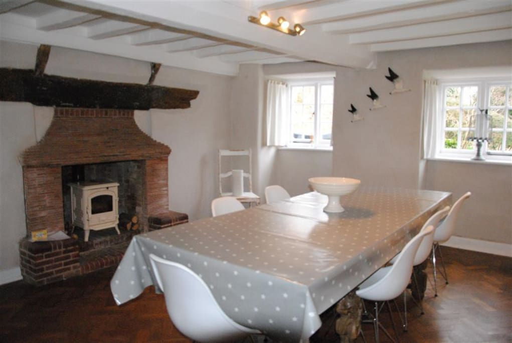 Dinning Room, easily seats 10, lovely white log burner