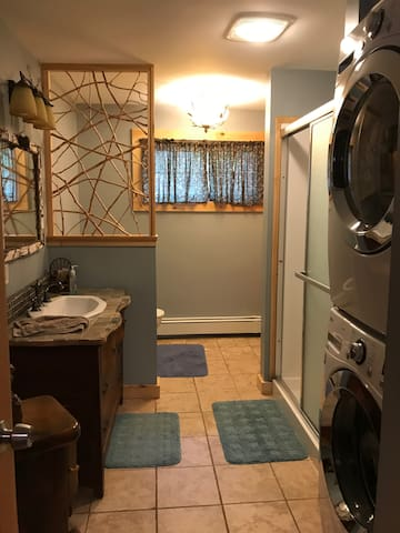 First floor bath and full size laundry facilities