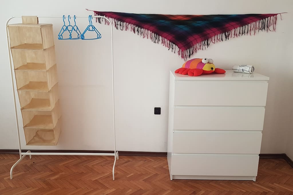 You get a large dresser and a minimalist rack to hang your clothes on.