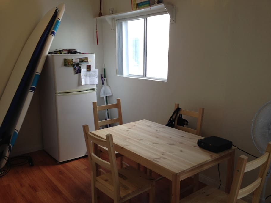 No need to eat out for every meal! Fridge and dining table.