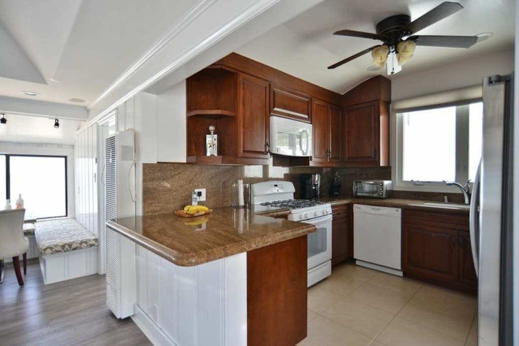 Full kitchen with all brand new appliances and marble countertops