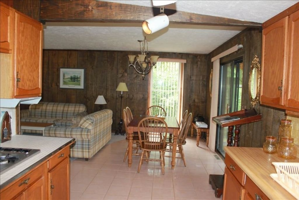 Full kitchen and spacious dining room. Additional dining table in the attached sunroom