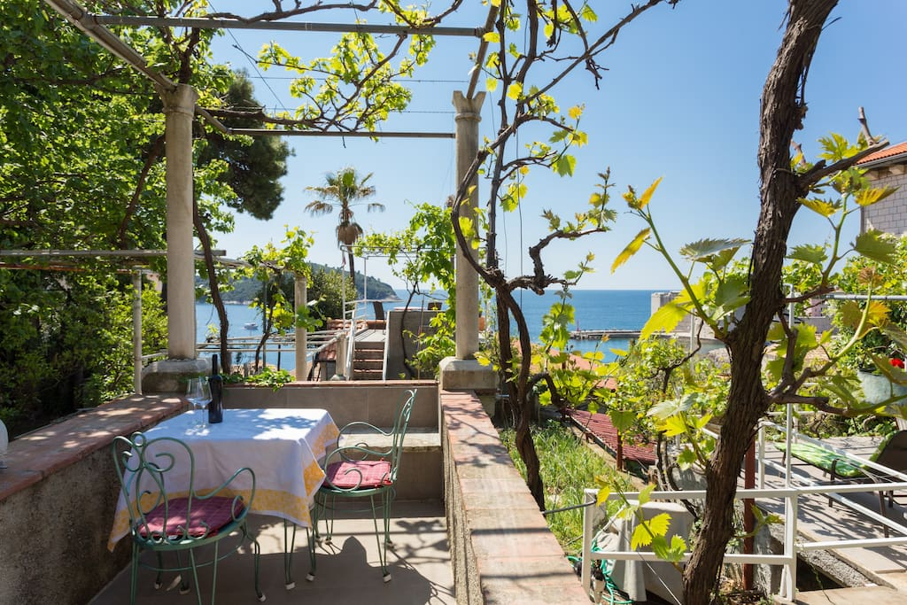 Terrace in front of the apartment with table and chairs and amazing sea & Old Town view
