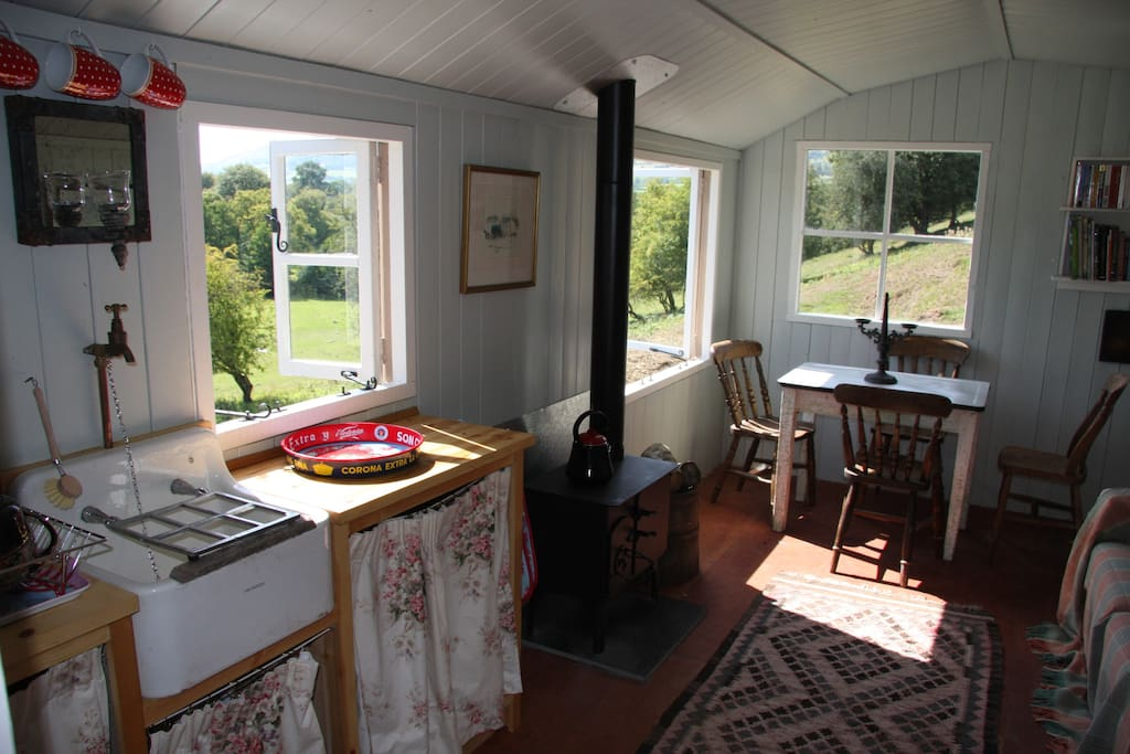 The hut is insulated, with woodburner, sink, gas hob, sofa bed and dining table.