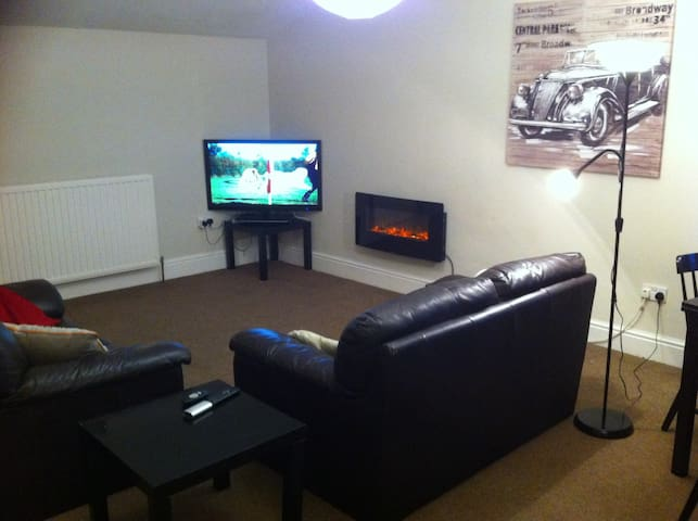 Lounge and dinning room with 3D Television and 3D DVD player