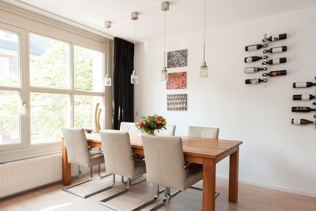 Light and spacious living/dining room with a large table