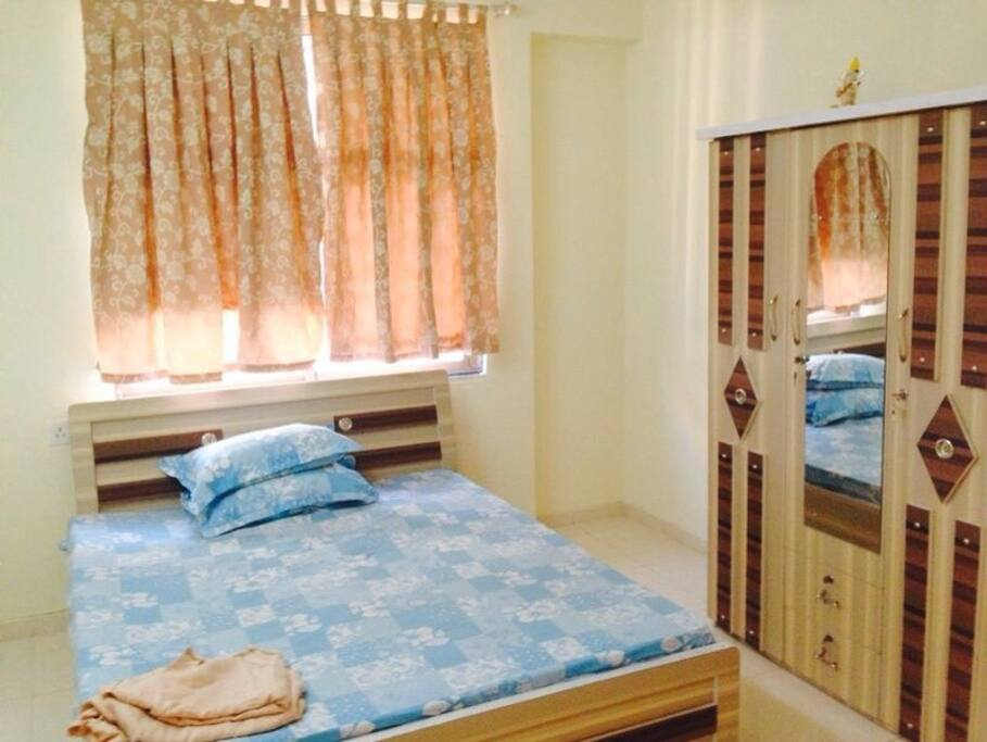 Double bed with attached bathroom