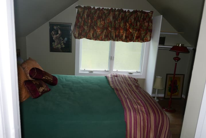 This is the queen bed.  Window AC unit is below this window.