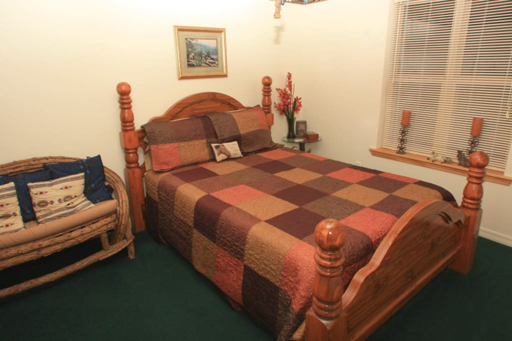 Queen size bed located down stairs