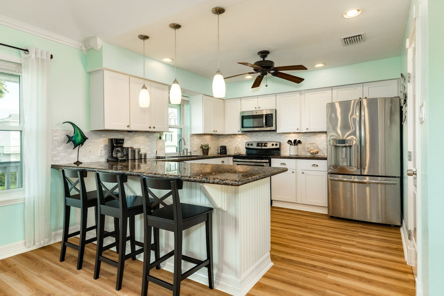 Fully stocked kitchen with granite counter-tops and stainless appliances.