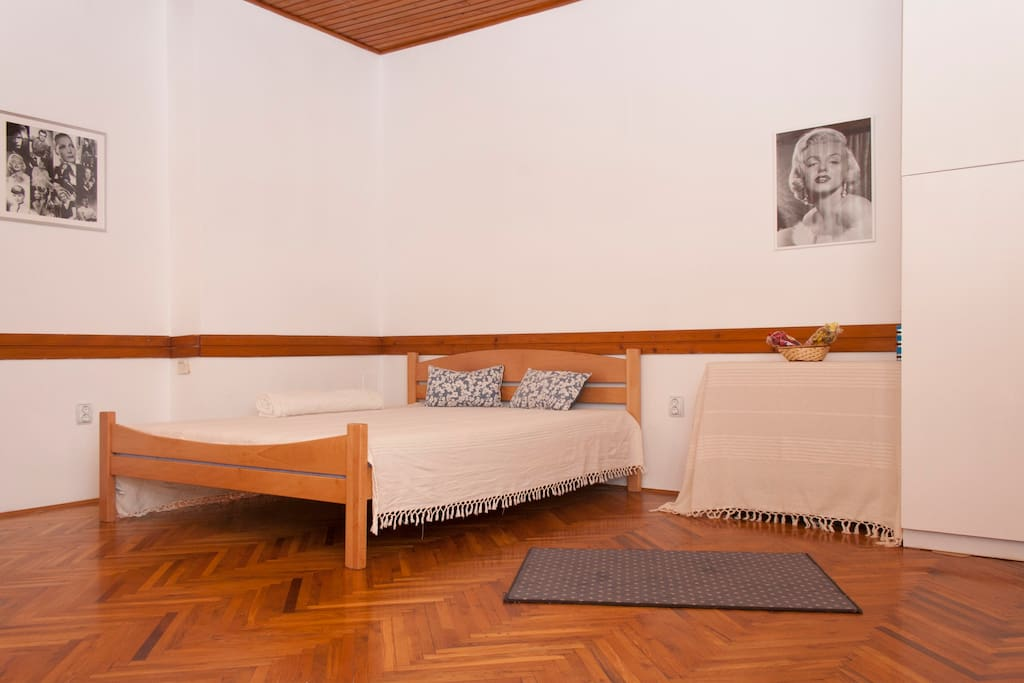 Comfortable master bed, approachable from two sides, with nice pillows and comfy bedlinen.