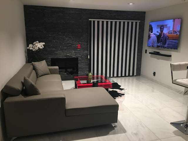 75' TV with Bose sound bar, marble floors
