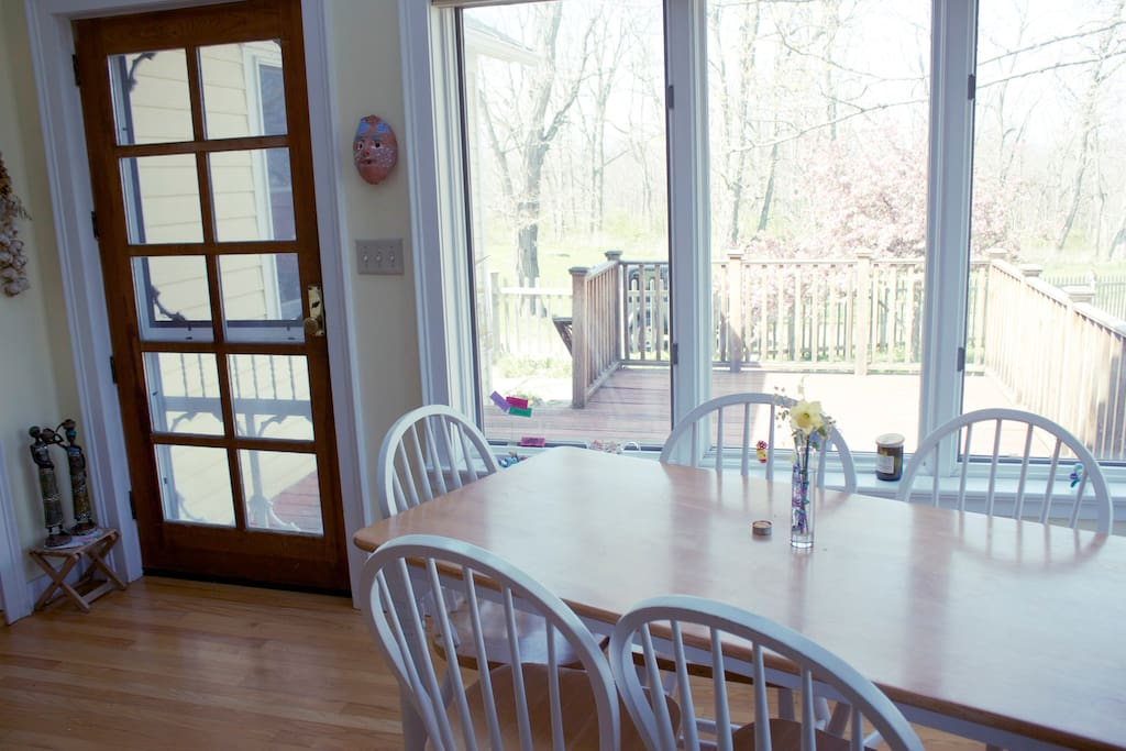A friendly eat-in kitchen with deck for outdoor eating in warm weather