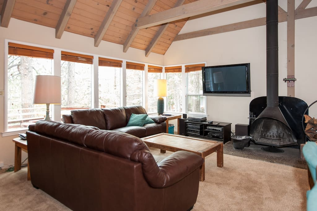 Flat screen tv and wood-burning fireplace