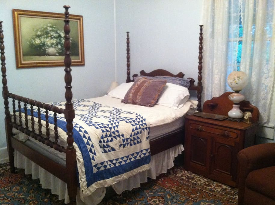 Third bedroom with four poster, antique dresser and furnishings, oriental rugs