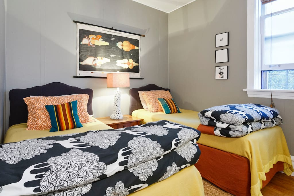 The second bedroom is outfitted with a pair of twin beds and cozy comforters (in winter).