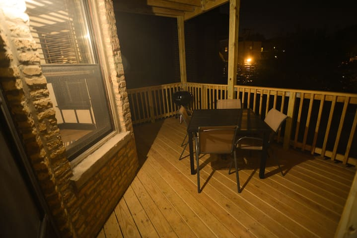 The private back deck is accessible both from the kitchen and living room