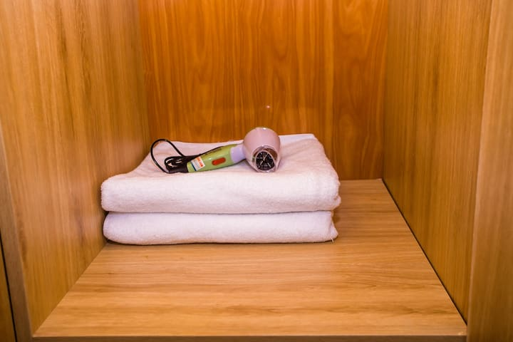 Towels, and hair dryer all ready to use.