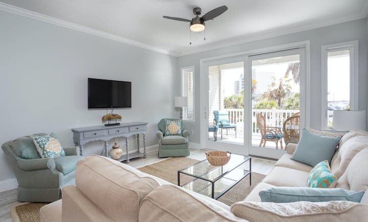 Renovated, ocean view condo w/ lovely porch - across the street from the beach!