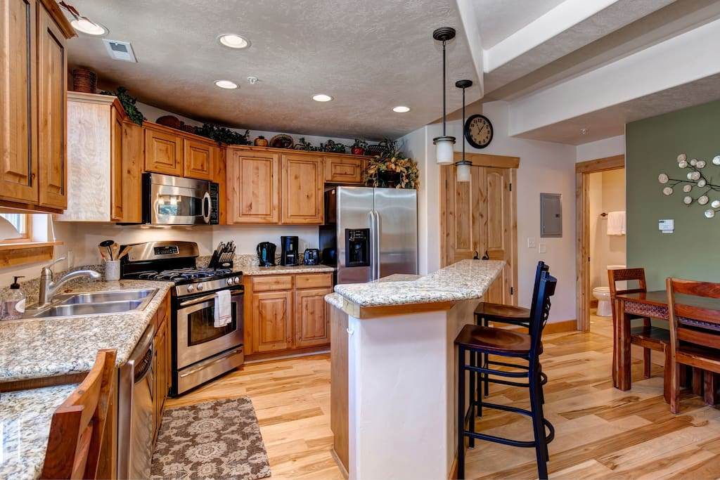 Fully equipped kitchen Granite counter tops and stainless appliances.
