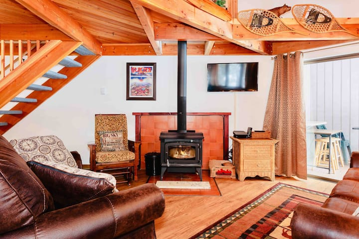 Enjoy our cozy warm living room with a real wood burning stove & unlimited wood!