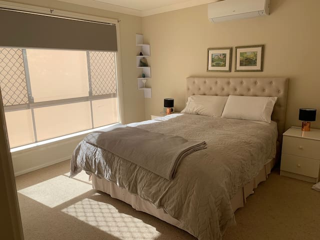 Stylish and comfortable master bedroom. Queen size bed with King size linen. En-suite and walk in robe, reverse cycle air conditioner.