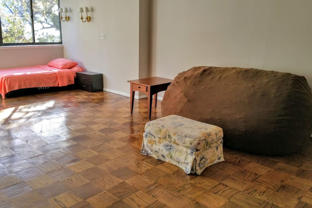 Large bean-bag sofa and ottoman footrest.