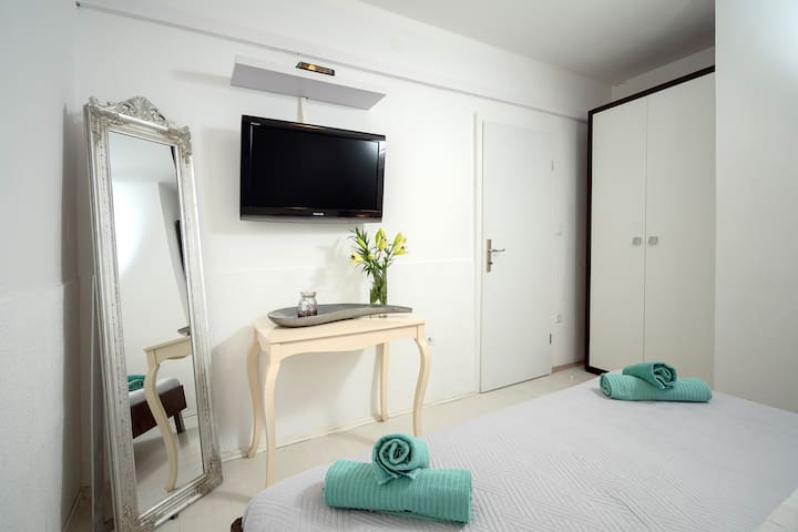The first bedroom, look from another side. Both bedrooms have satellite TV and air-conditioning.