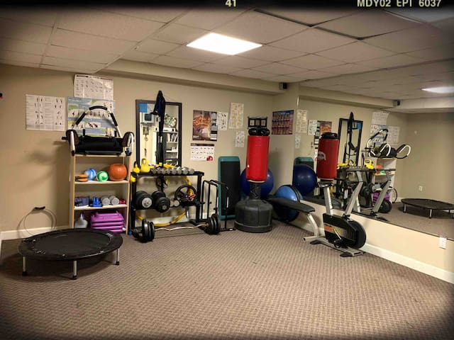 Fitness room for workout needs. This room will also include a floor queen sized mattress, when the booking calls for extra guests above 2 people.